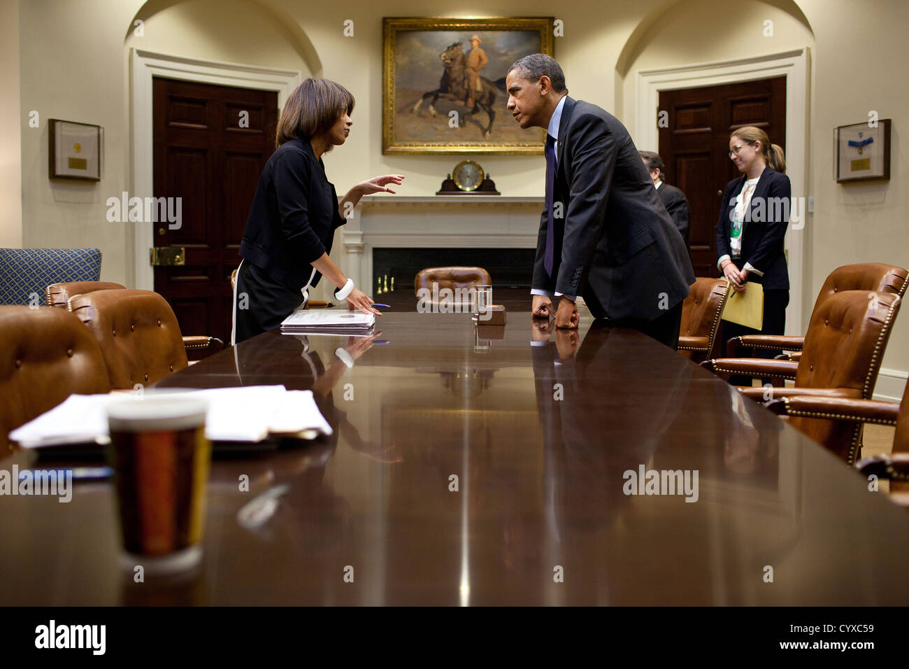 US President Barack Obama talks with Melody Barnes, Domestic Policy Council Director following a meeting on immigration - Stock Image