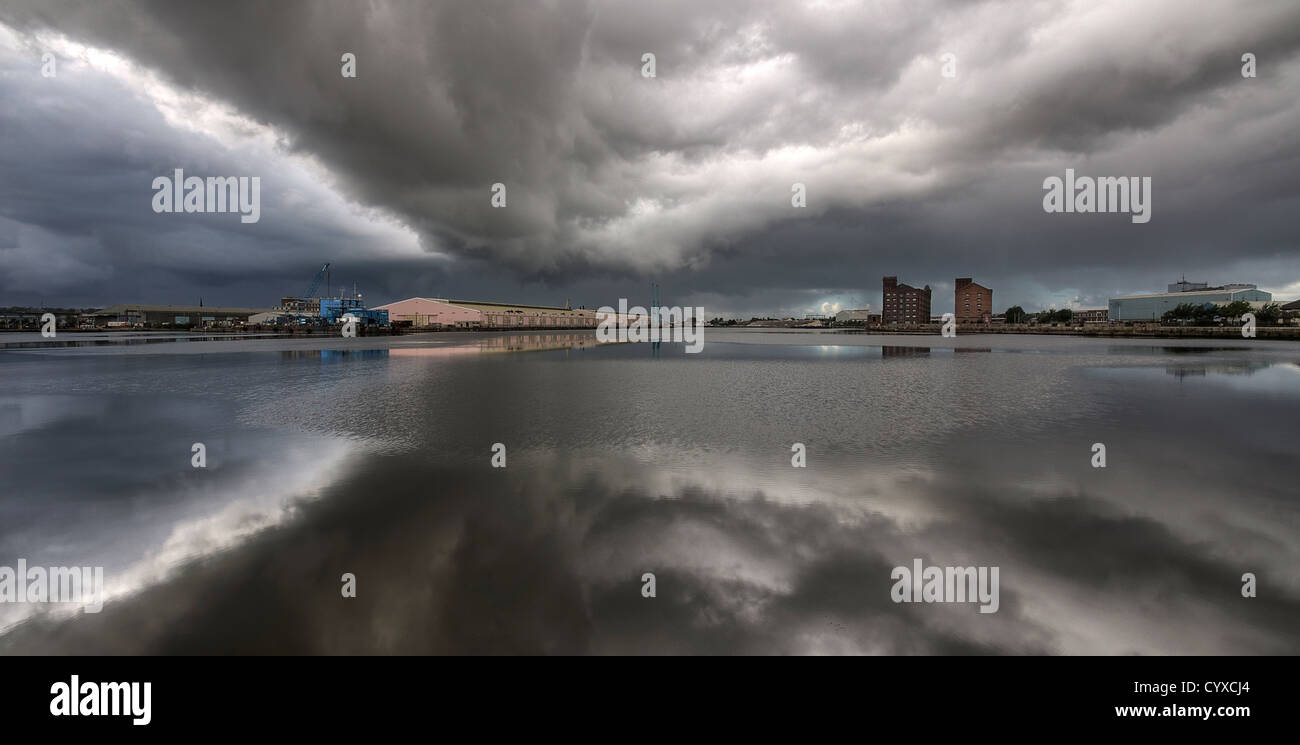 Birkenhead dock docklands water front with a stormy sky - Stock Image