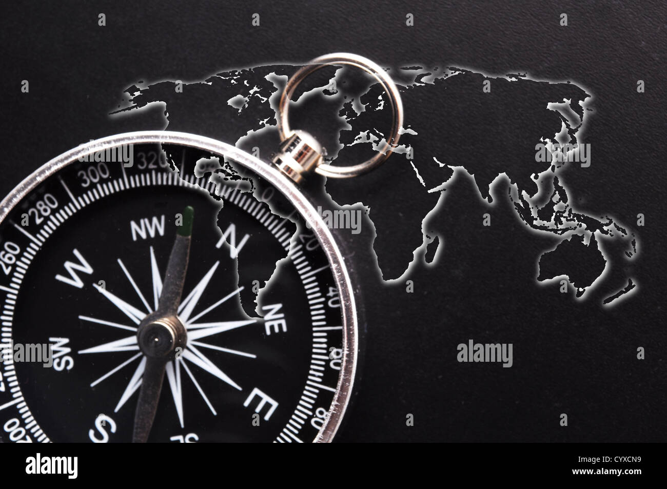 world map and compass showing business guidance concept - Stock Image