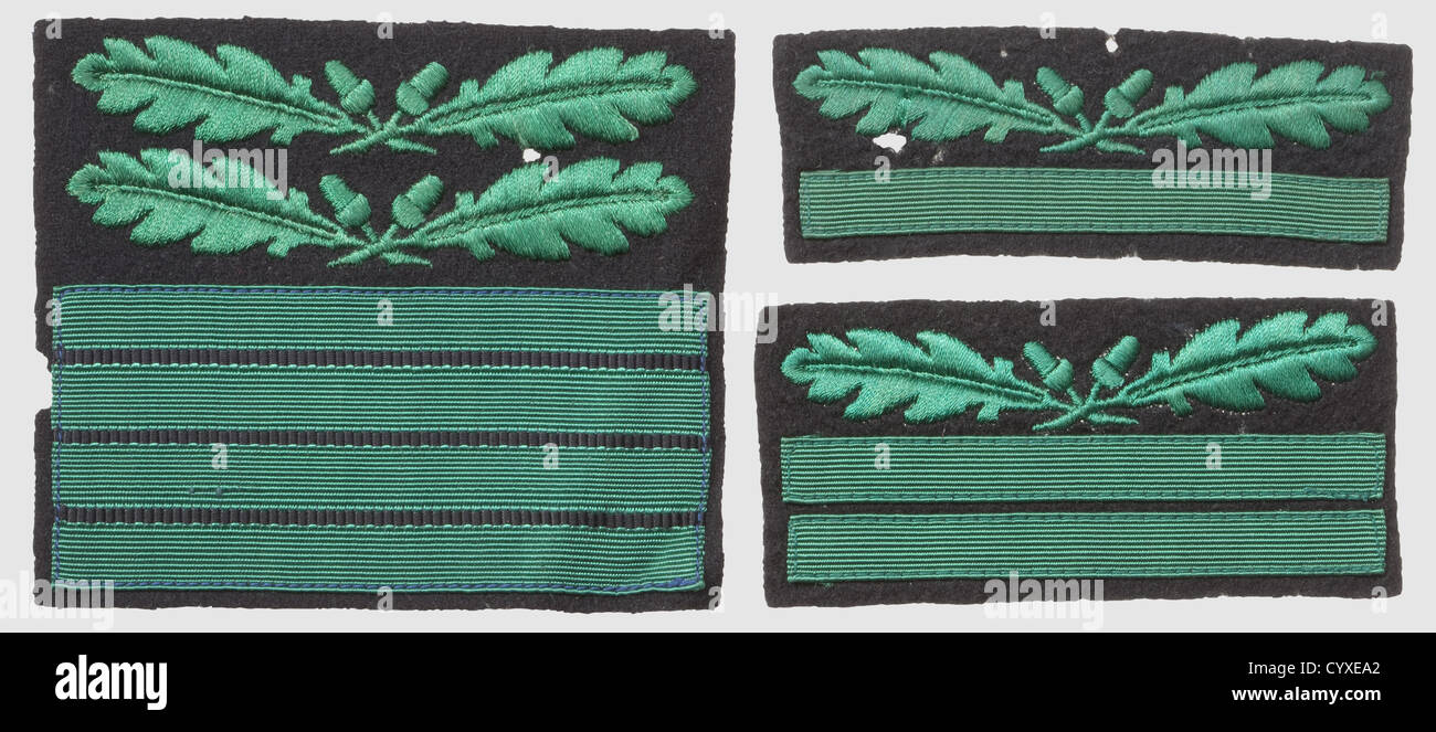 Three rank-badges for the camouflage-uniform, RZM-machine-embroidered issues, green on black cloth for 'SS-Oberführer', - Stock Image