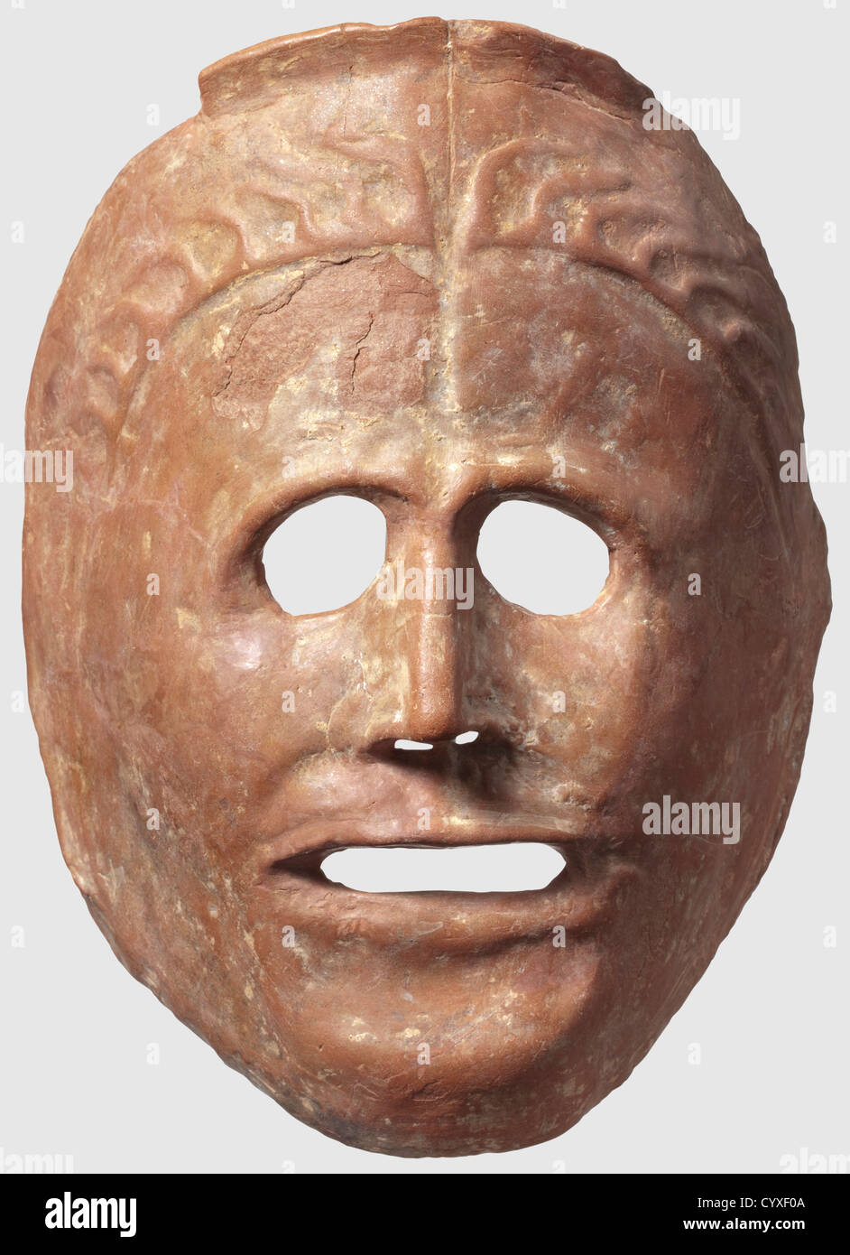 A Greek theatre mask, 6th/5th century B.C. Reddish ceramic. Semicircular, naturalistically modelled mask with openings - Stock Image