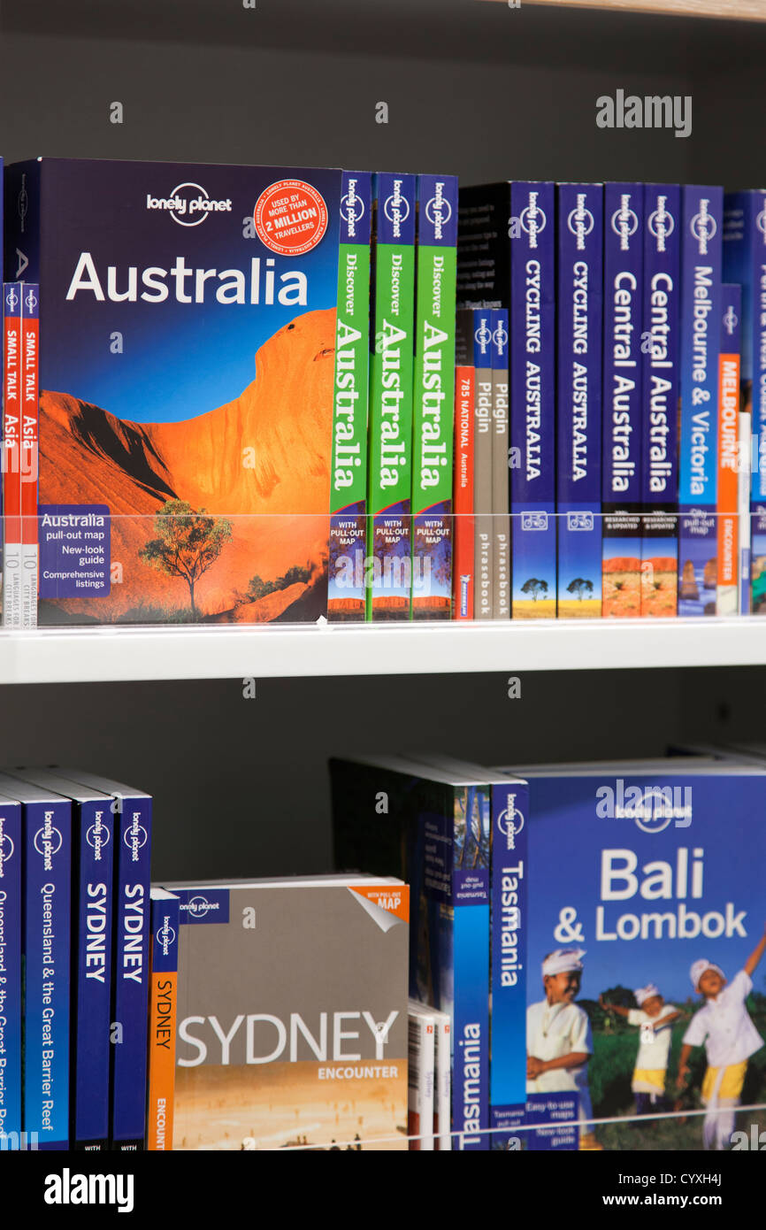 Lonely Planet guides on bookshelf in Lonely Planet shop, Manchester  airport, Manchester, UK
