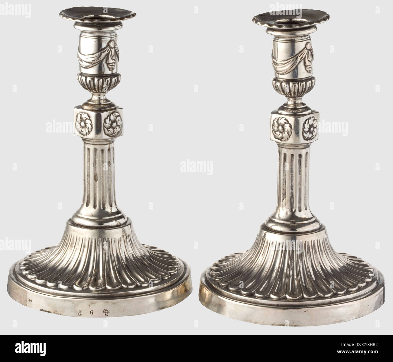 A pair of neoclassic silver candle holders, Dresden circa 1780/90 Feet with gadrooned decoration in relief. Short, - Stock Image