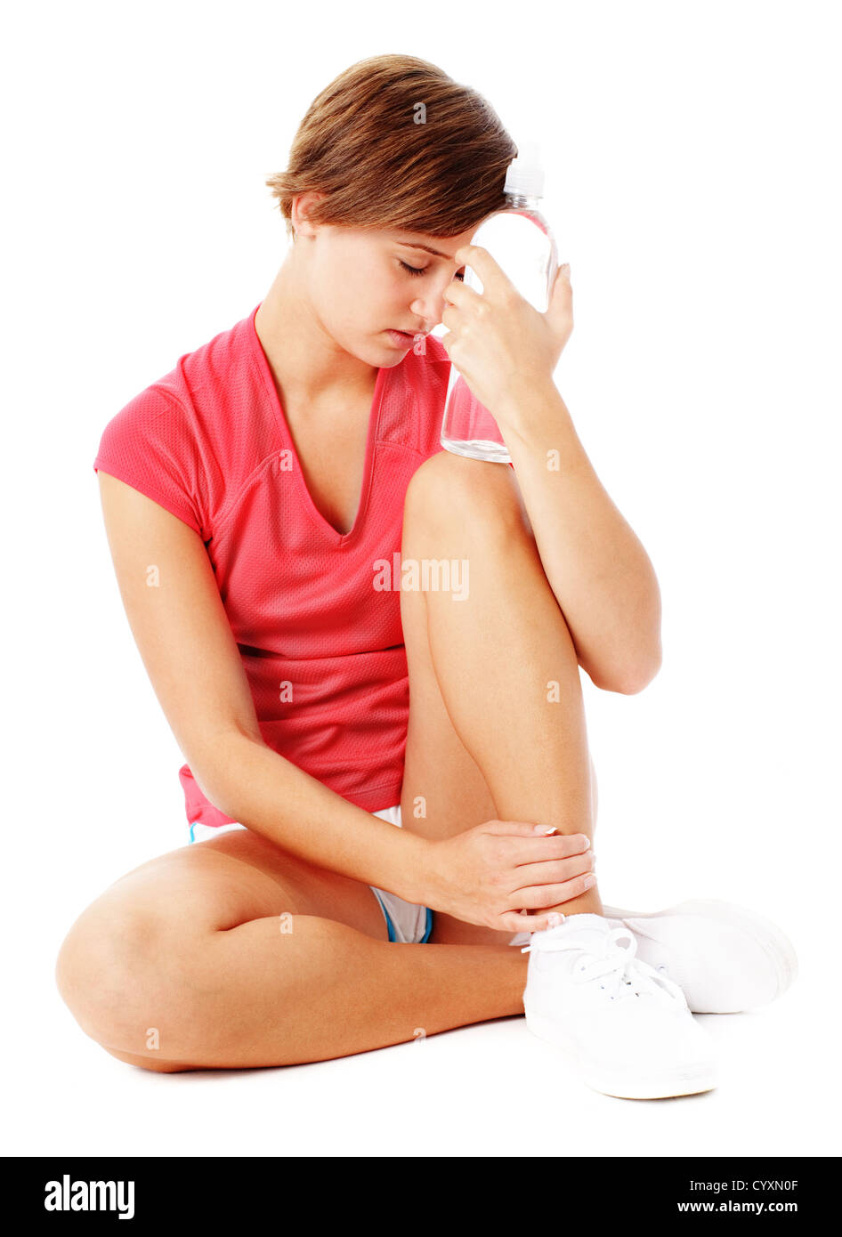Young woman resting after excercise, from a complete series of photos. - Stock Image