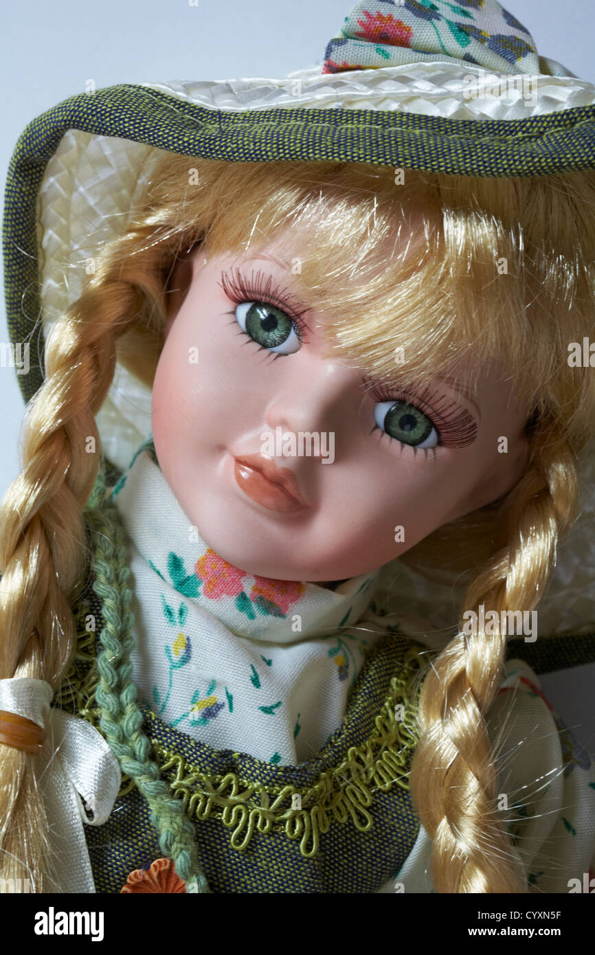 Beautiful doll with long blond hair in plaits and long eyelashes - Stock Image