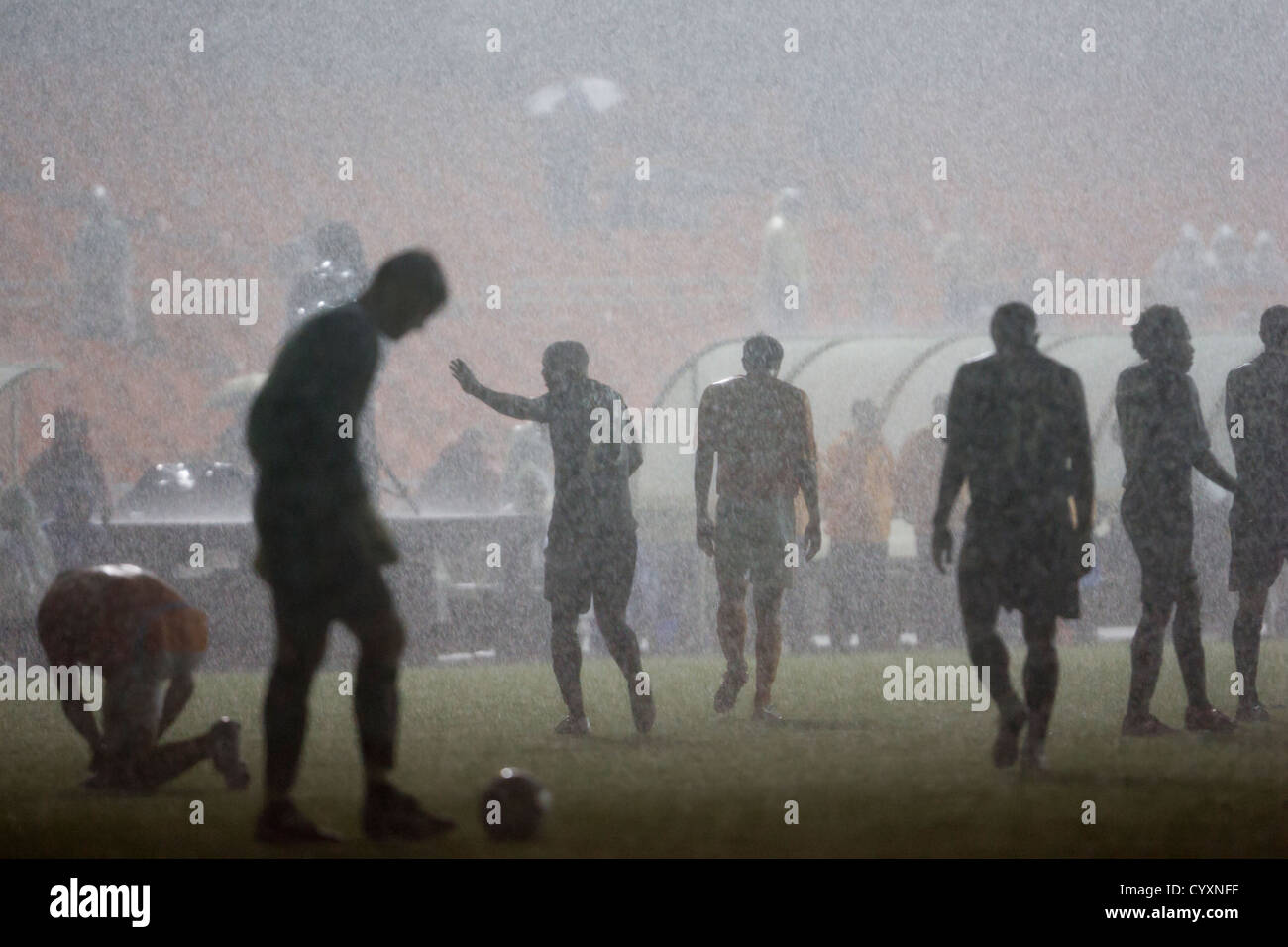 DC United and Houston Dynamo players leave the pitch for safety while a storm caused power outage causes a delay - Stock Image