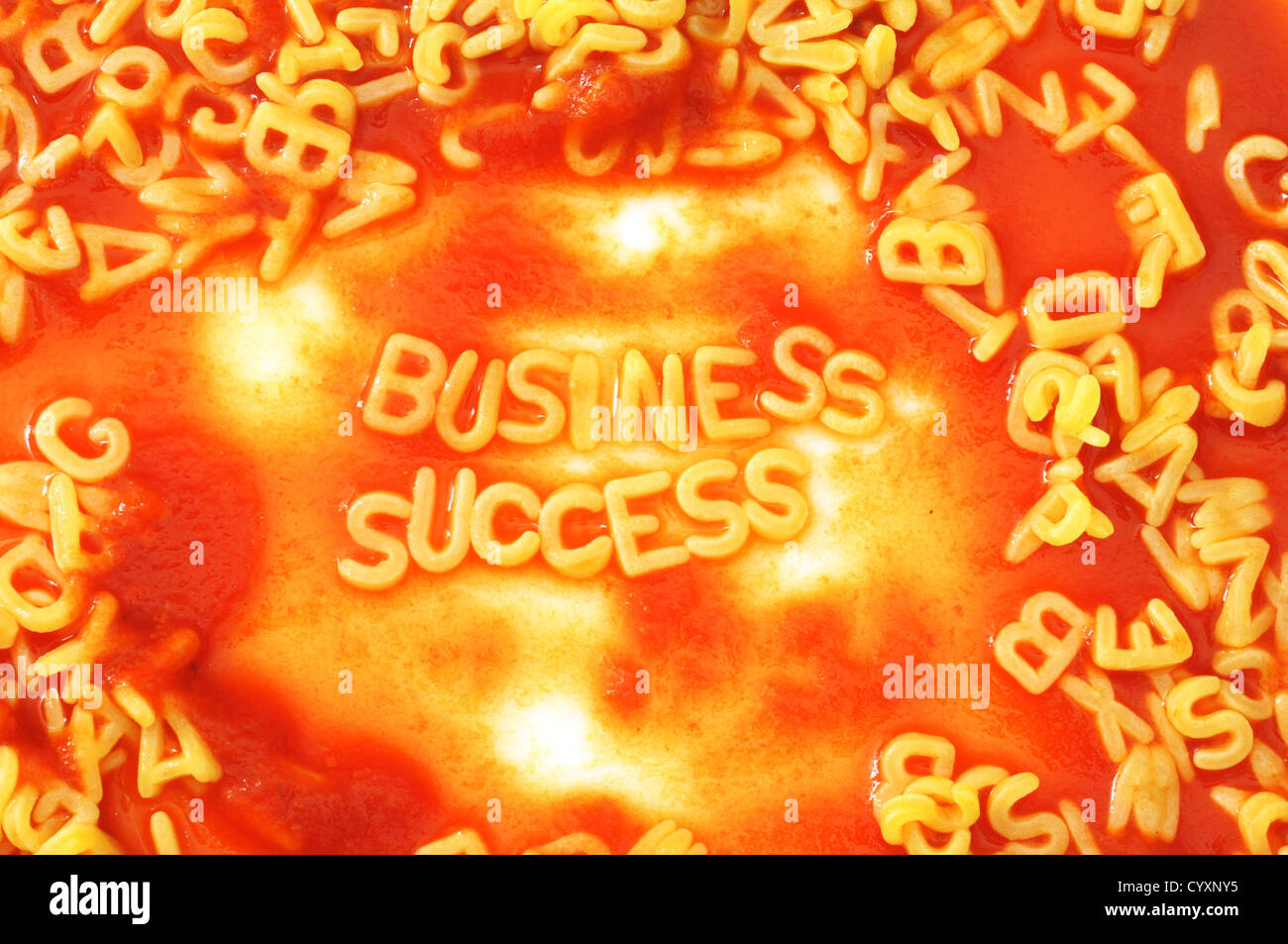 business success shown by food alphabet at lunch - Stock Image