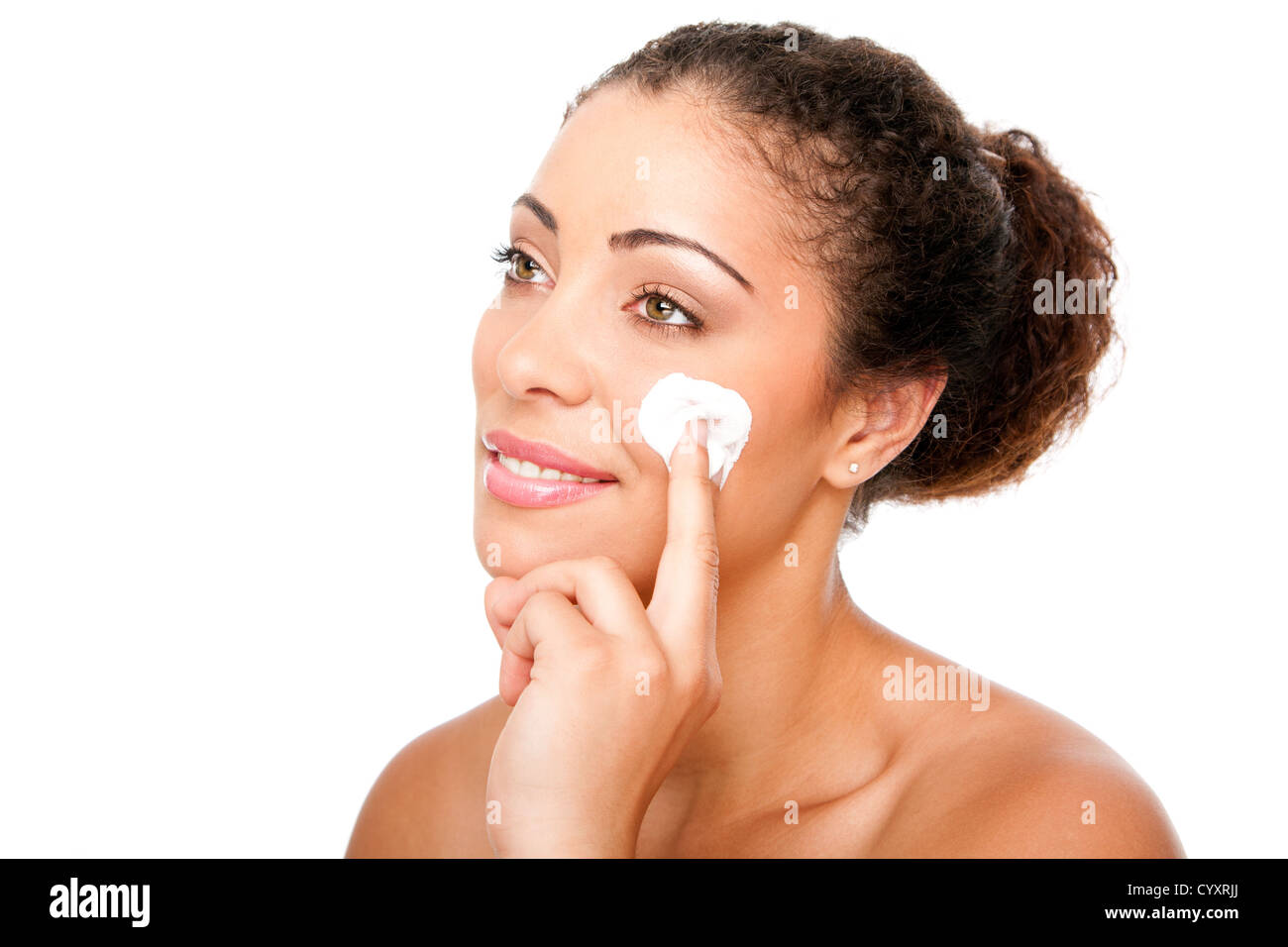 Beautiful face of young woman with hand applying exfoliating anti wrinkle cream beauty treatment for skincare, isolated. - Stock Image