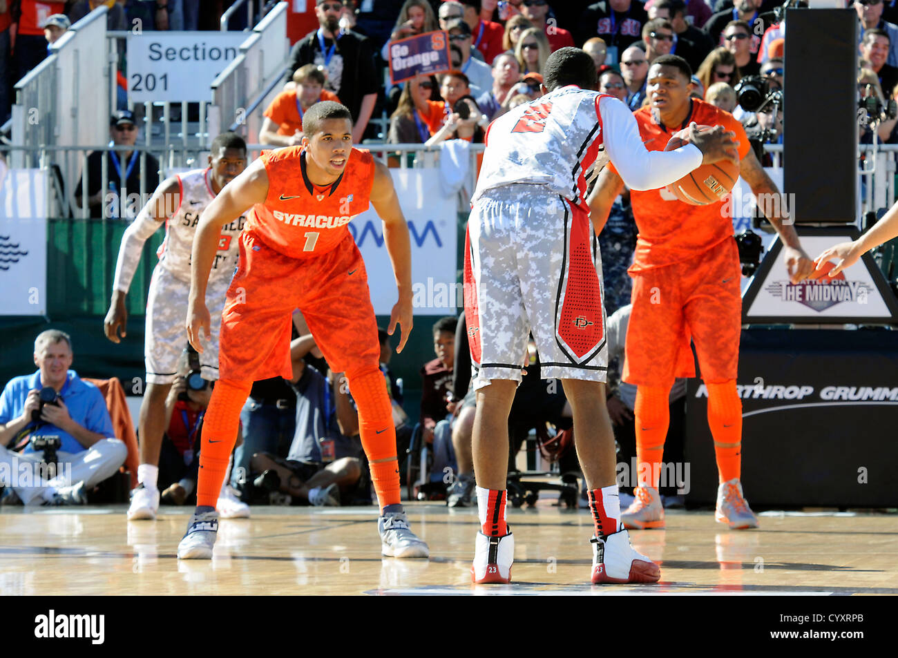 "Syracuse University Michael Carter-Williams defends San Diego State University Xavier Thames during the ""Battle - Stock Image"