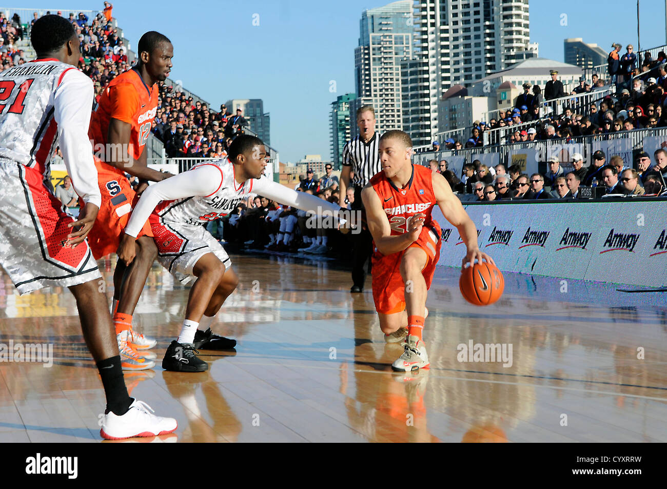 SAN DIEGO (Nov. 11, 2012) San Diego State University Chase Tapley, defends Syracuse University Brandon Triche, onboard - Stock Image