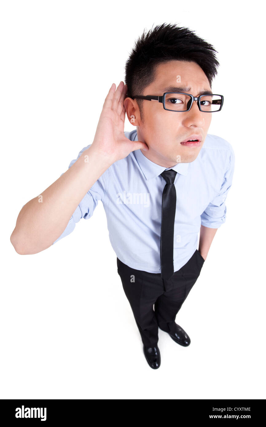 young businessman listening - Stock Image