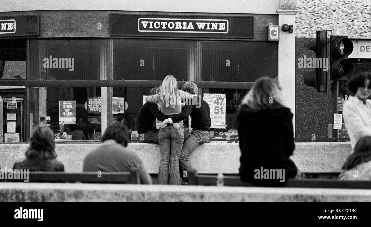Hastings town centre in 1977. The sharing trio in the middle of the scene were foreign students attending the language - Stock Image