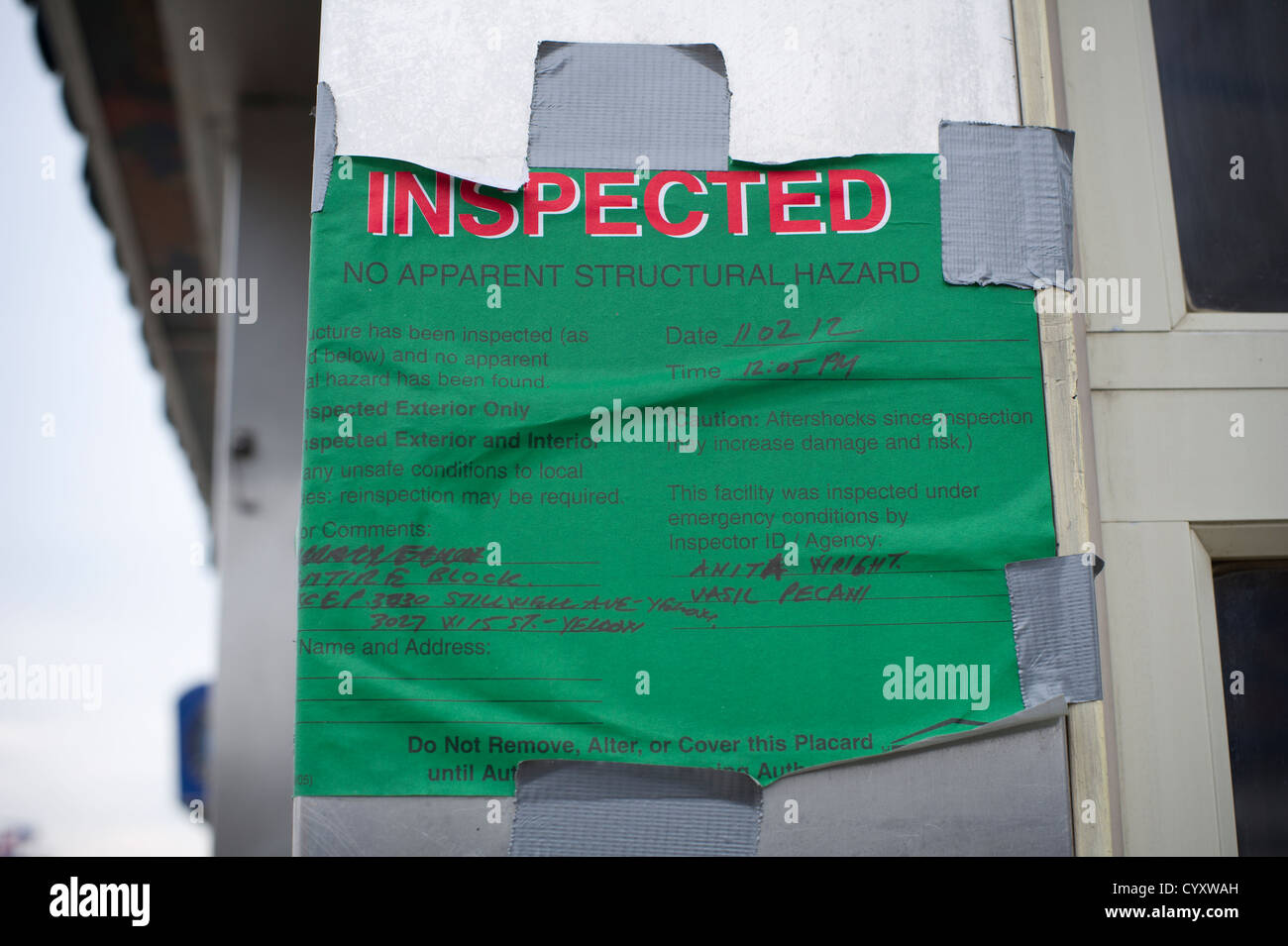 Sign posted by New York City states the building has been inspected and no apparent structural hazard was found - Stock Image