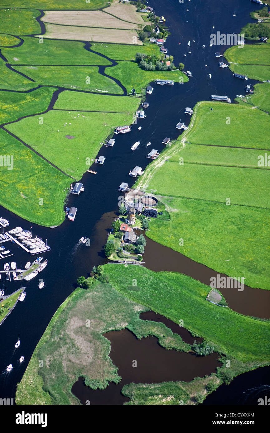 The Netherlands, Warmond, Windmill, yachts and houseboats in lakes called Kager Plassen. Aerial. - Stock Image