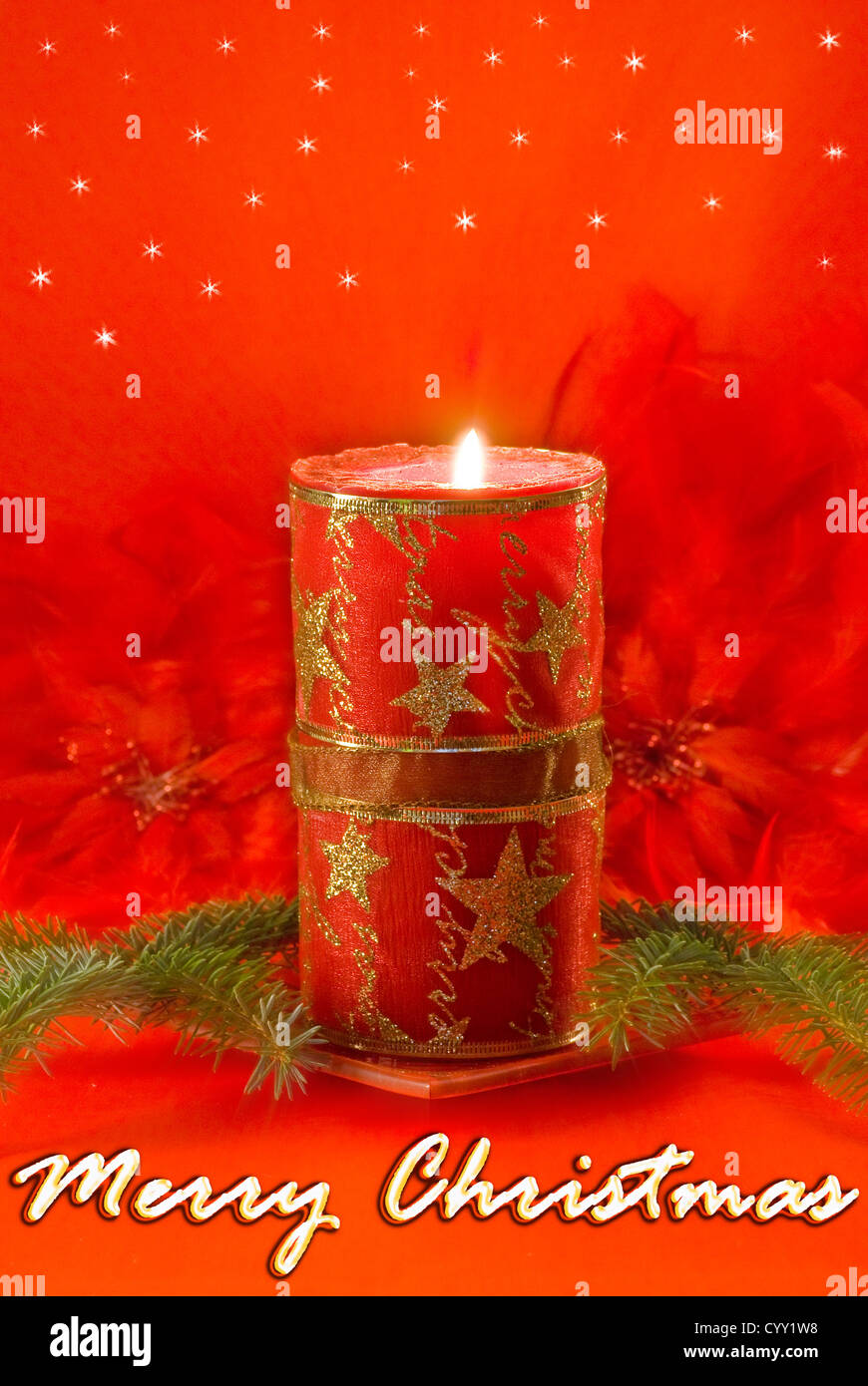 Christmas decorations - red candle, spruce twig and red feathers - Stock Image