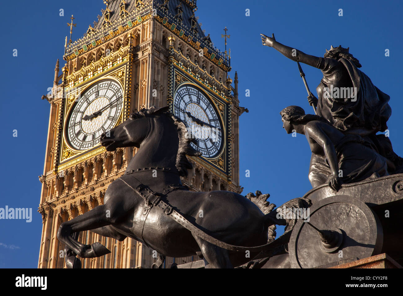 Horse and chariot statue of Queen Boudicca and her daughters below Big Ben at Embankment, Westminster, London England, Stock Photo