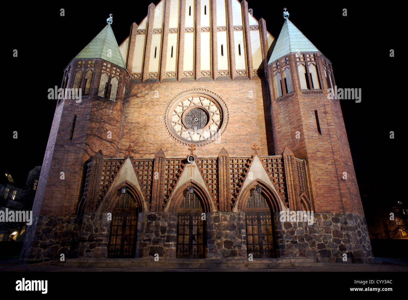 Facade Of Gothic Church At Night In Poznan Poland