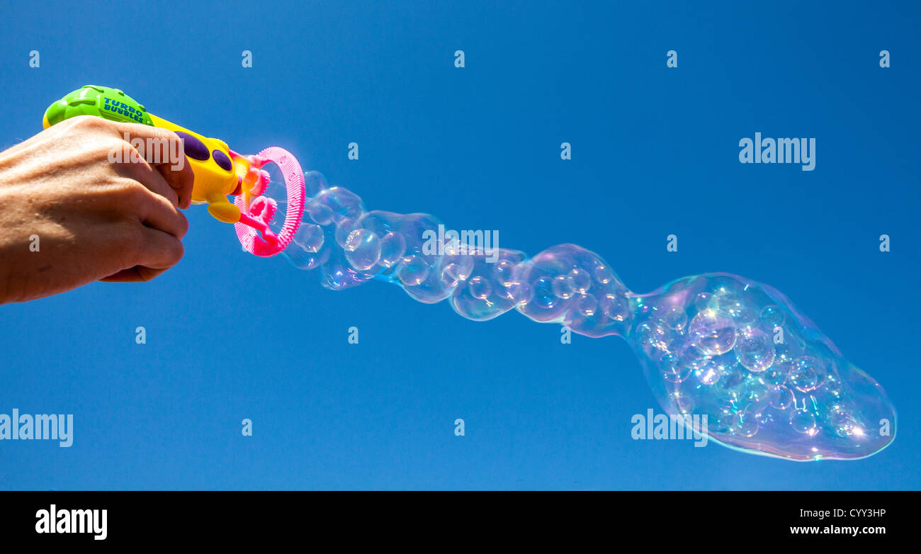 Ring Bubble Blowers : Soap bubbles air is blowing through a ring covered with