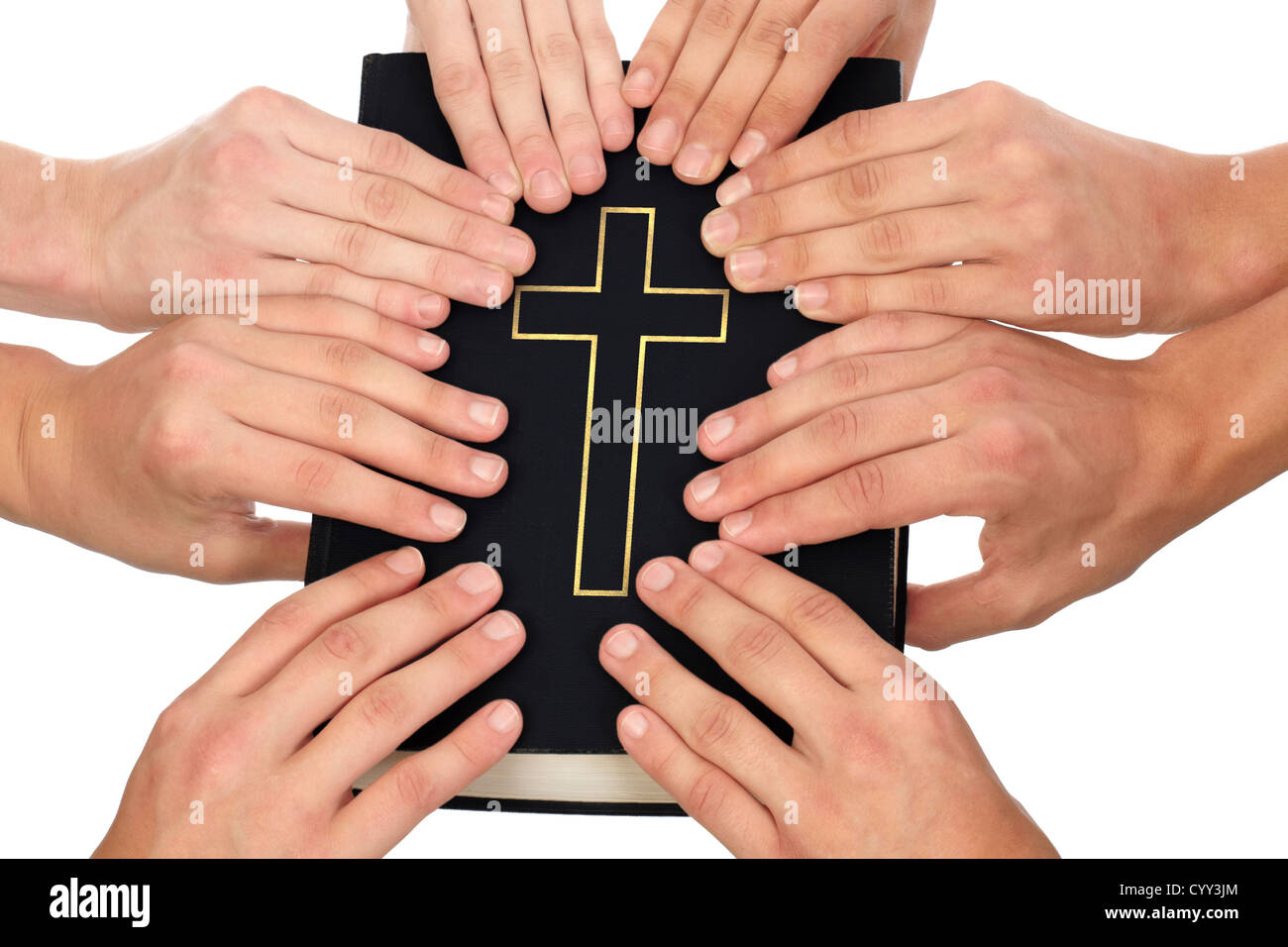 Group of people holding Holy Bible to unity and prayer - Stock Image