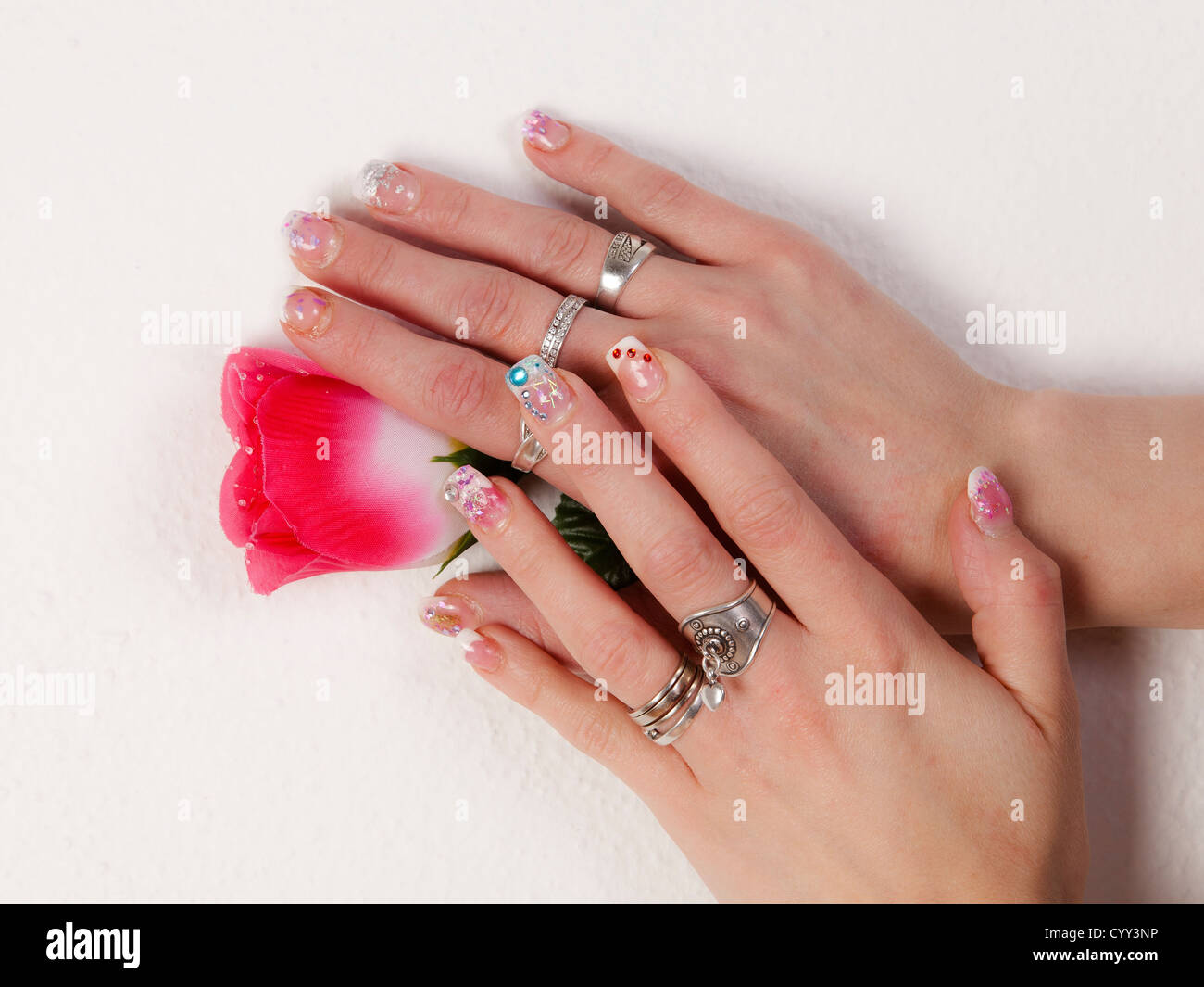 Fake gel nails in fingers Stock Photo: 51612114 - Alamy