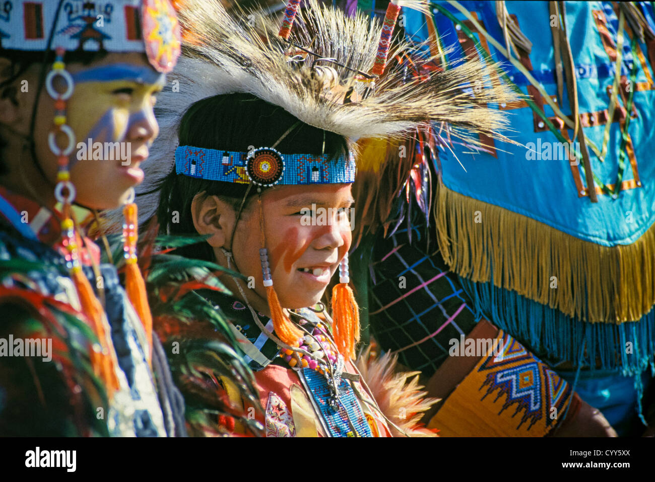 Native American boys in dance regalia at powwow. - Stock Image