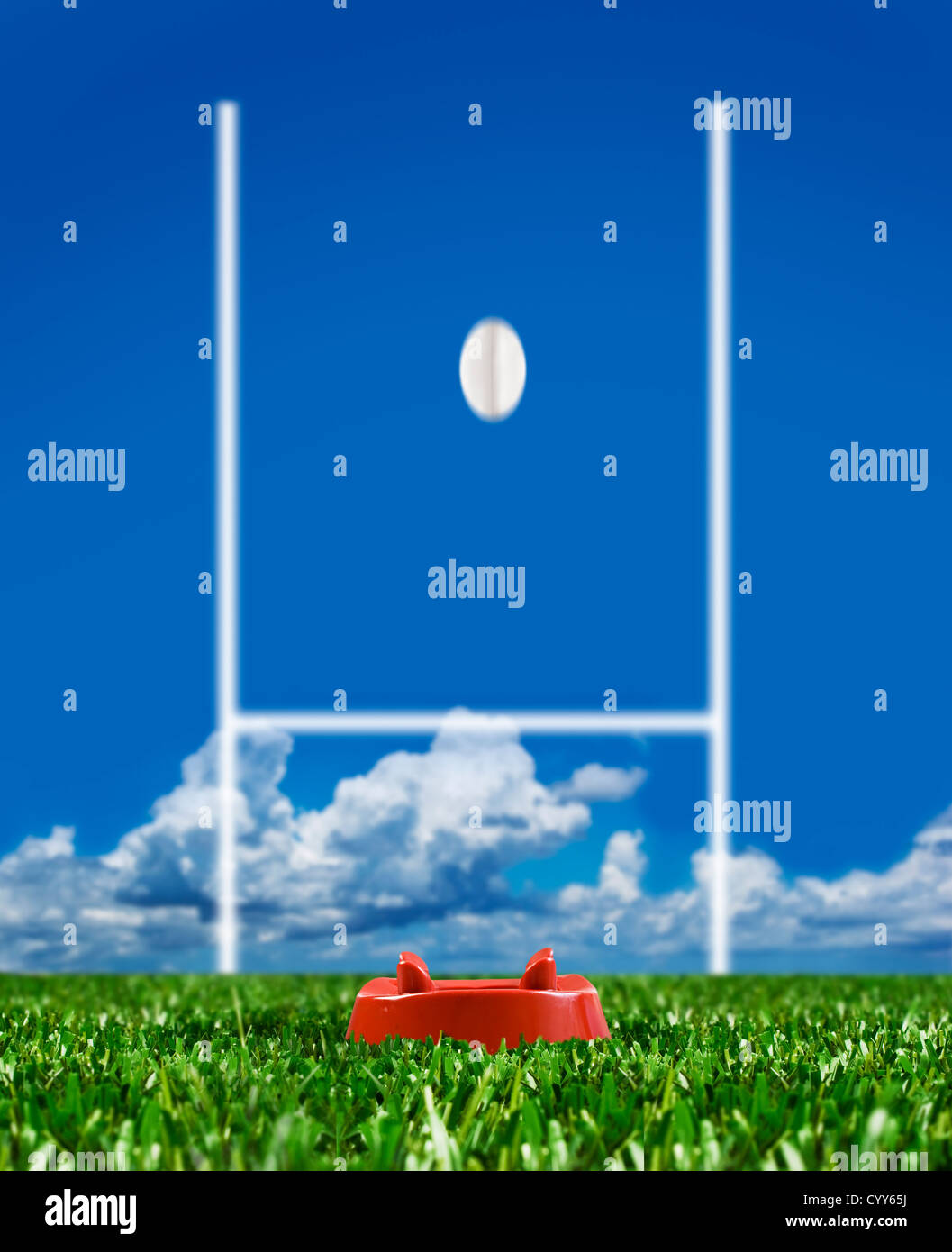Rugby ball kicked to the posts on a rugby field showing movement - Stock Image