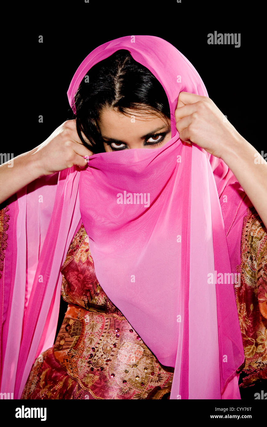 Arabian woman wearing traditional dress on black background - Stock Image