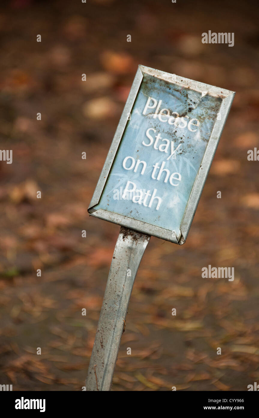 'Please stay on the path' sign at Portland Japanese Garden; Portland, Oregon. - Stock Image