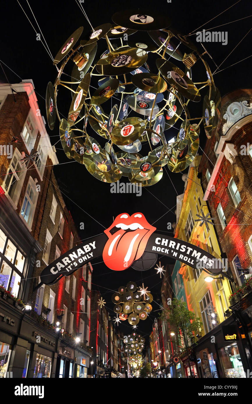 london uk 12th november 2012 christmas lights and decorations in carnaby street with a rock n roll records theme london