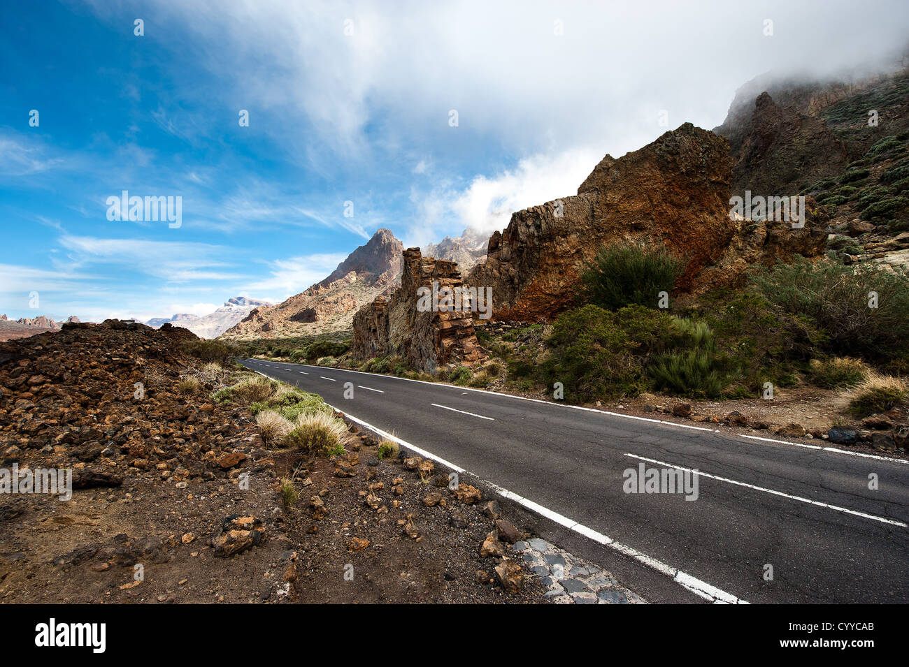 View volcanic desert road in mountain, located in the mountains of the island of Grand Canary in the Canary Islands - Stock Image
