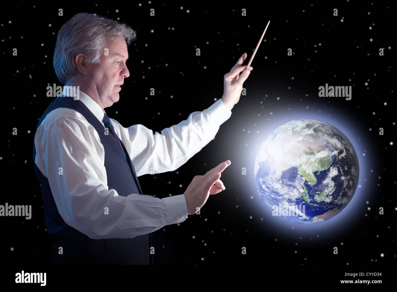 Business man trying to influence the blue planet - Earth globe image provided by NASAhttp://www.earthobservatory.nasa.gov. - Stock Image