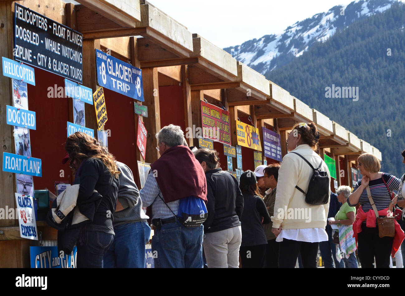Tourists from a cruise ship booking tours in Juneau, Alaska. - Stock Image