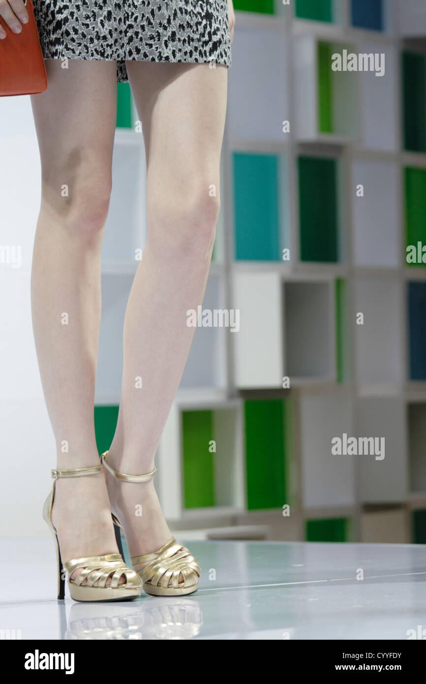 female model's long slim beautiful legs in high heels - Stock Image