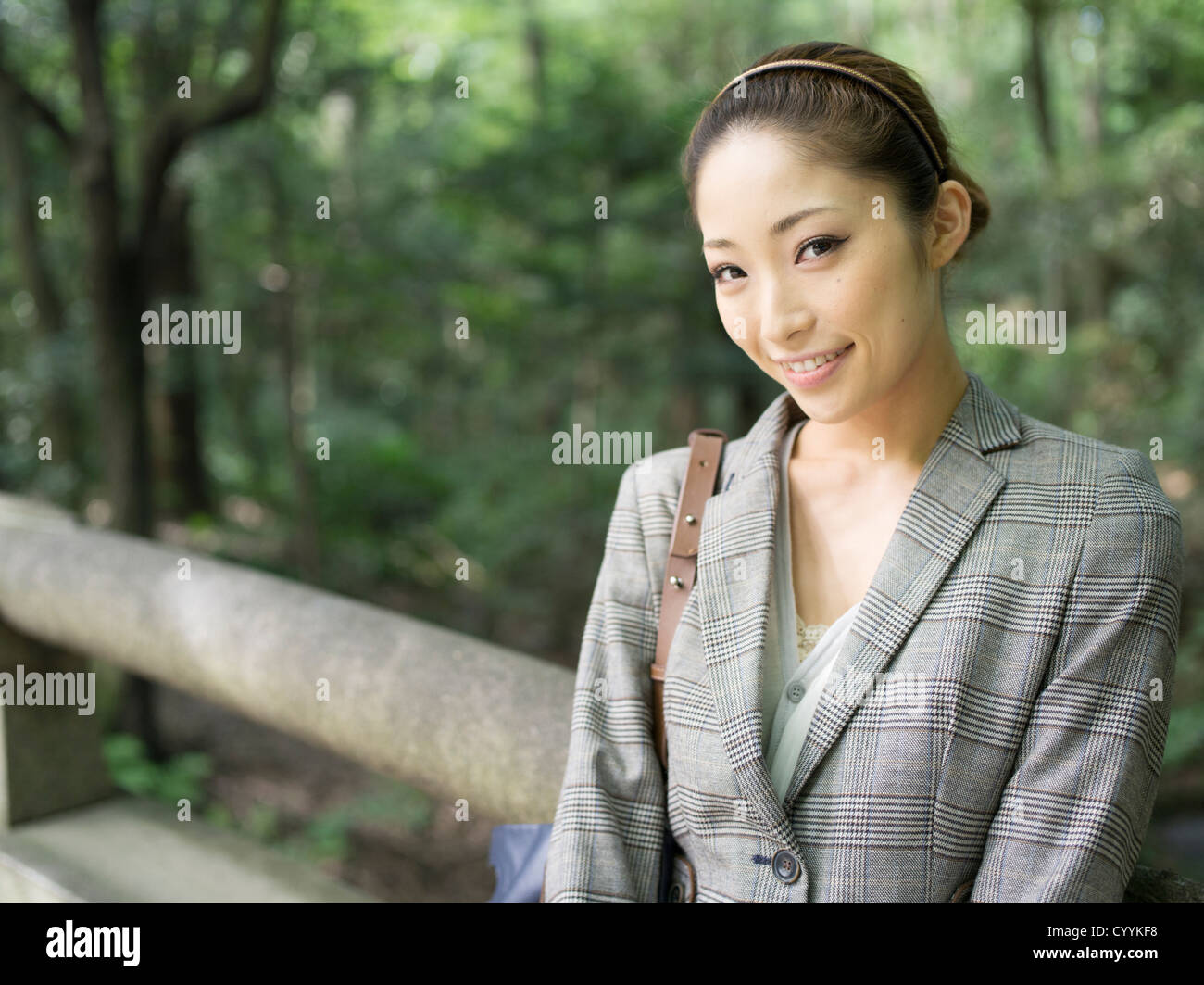 Beautiful young Japanese woman with tweed jacket - Stock Image