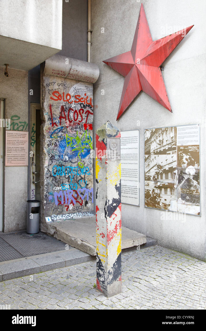 DDR plaque and red star in Berlin - Stock Image