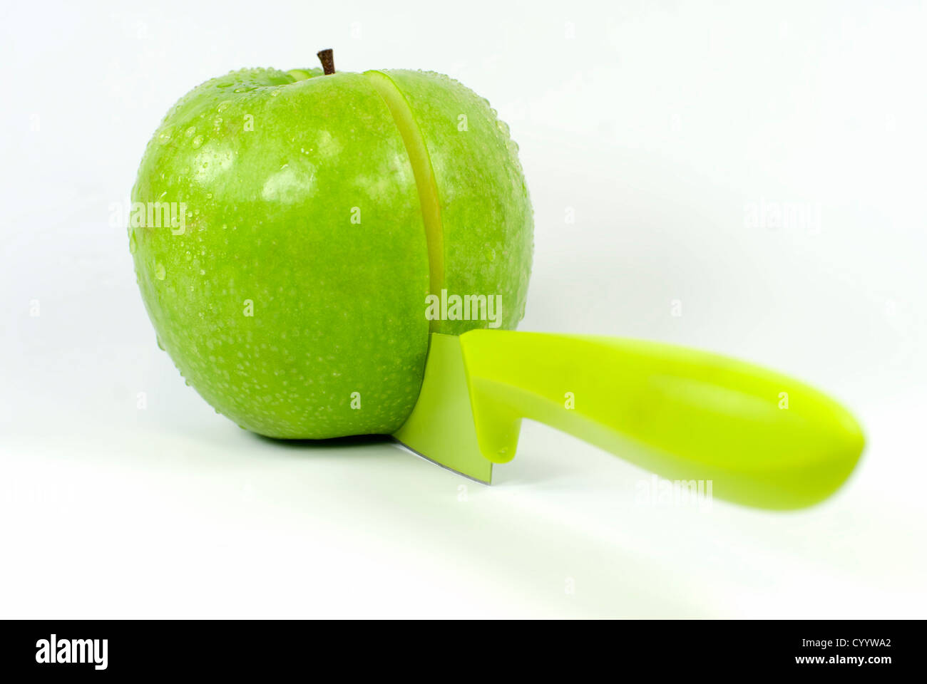 Sharing an apple with a knife Stock Photo