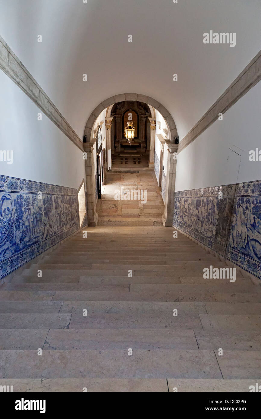 Staircase decorated with blue tiles (azulejos). Sao Vicente de Fora Monastery. Mannerist architecture. Lisbon, Portugal. - Stock Image