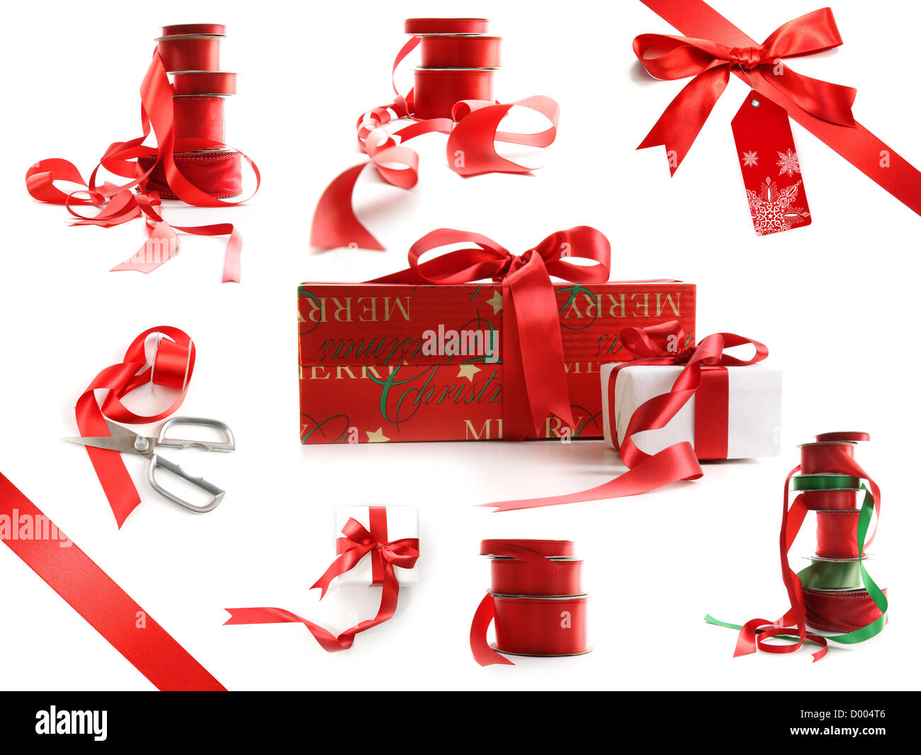 Different sizes of red ribbons and gift wrapped boxes isolated on white background - Stock Image