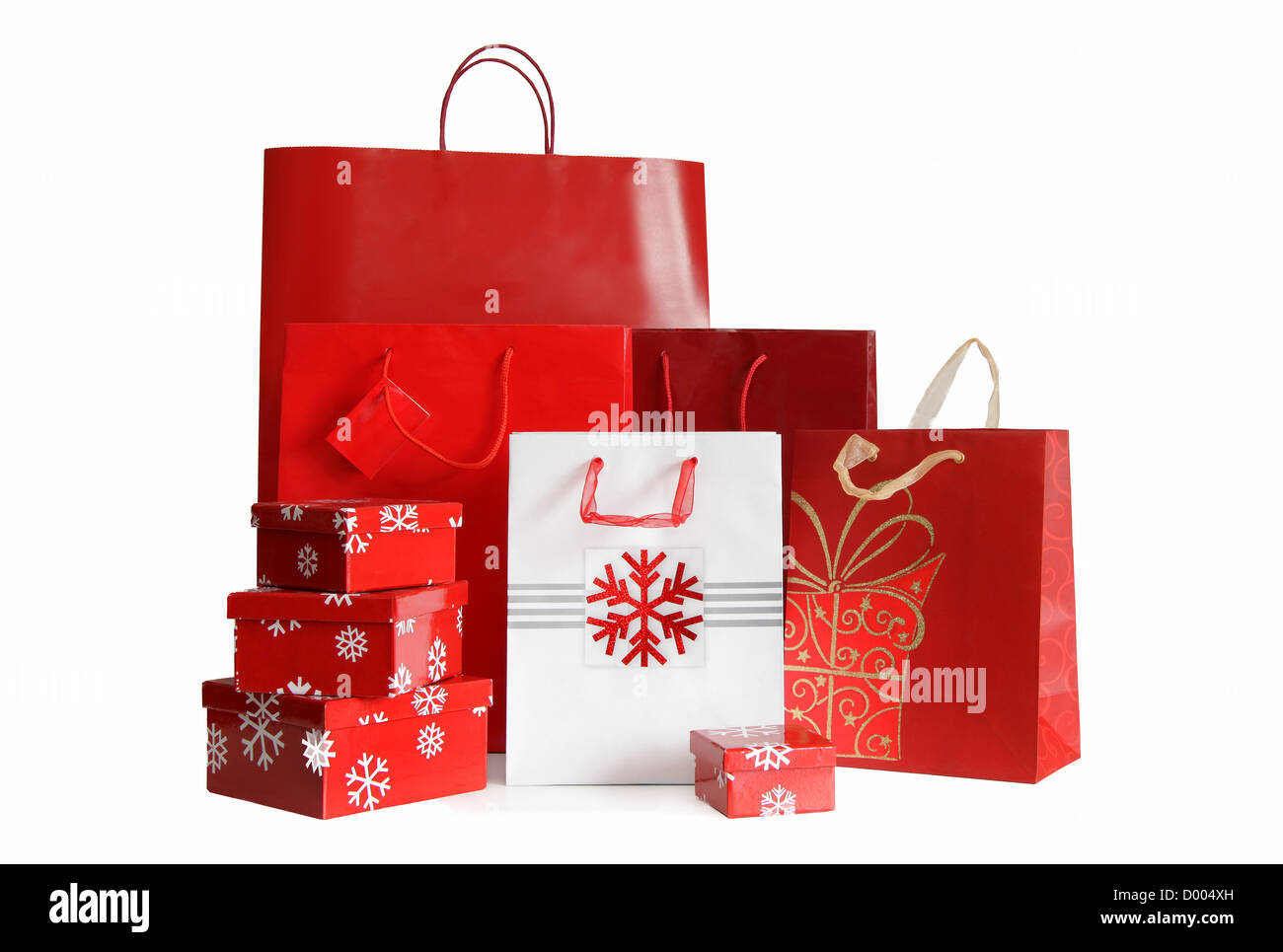 Various sizes of holiday shopping bags and gift boxes on white background - Stock Image