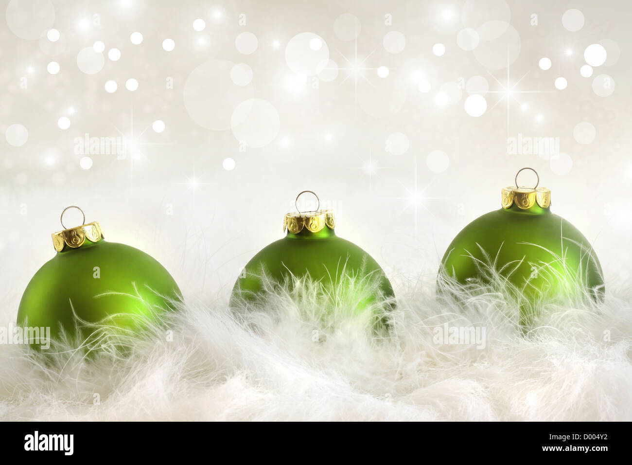 Green christmas balls with holiday background - Stock Image