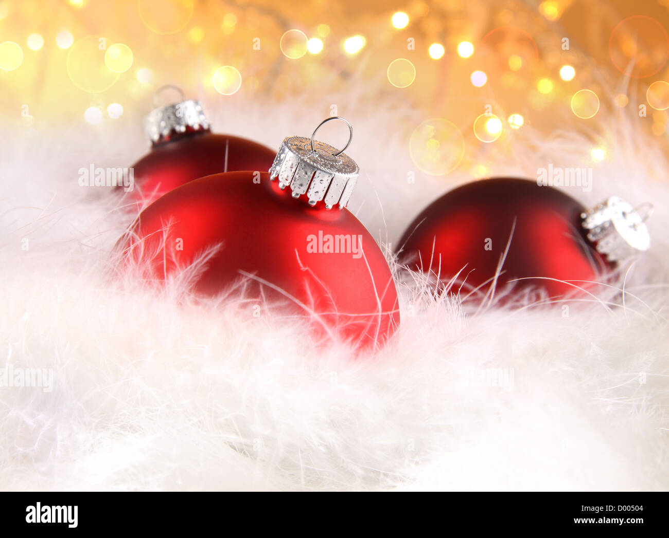 Red christmas balls with abstract holiday background - Stock Image