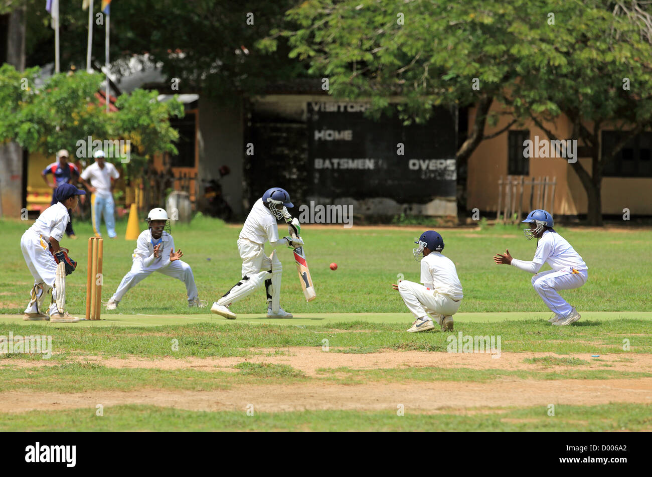 Schoolboys playing inter school cricket match in Tissamaharama, Sri Lanka. - Stock Image