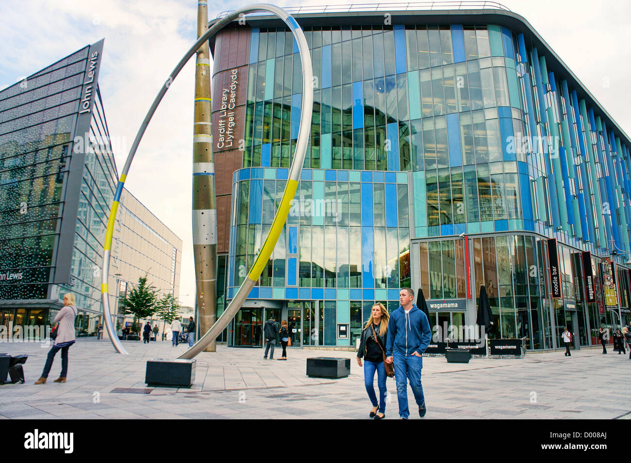 Alliance sculpture by Jean-Bernard Metais. John Lewis store (left) and Central Library. The Hayes, Cardiff city Stock Photo