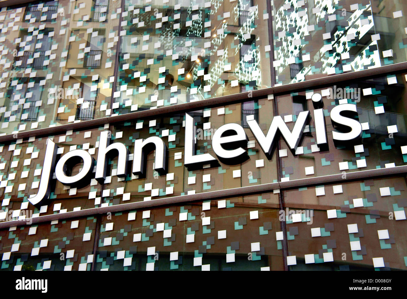 John Lewis department store logo on glass facade of new store. The Hayes, Cardiff city centre, Wales - Stock Image