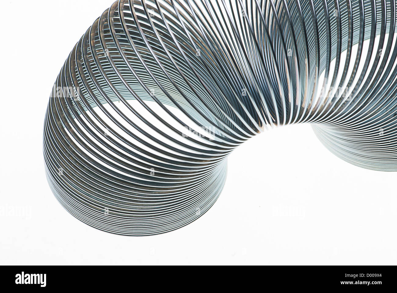 Isolated Slinky on white - Stock Image