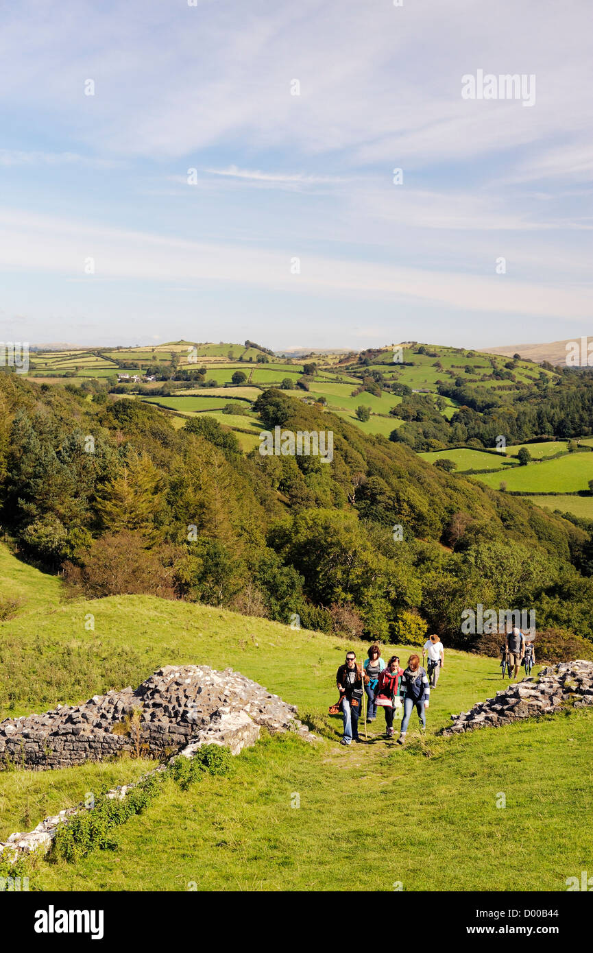 Walkers in the Brecon Beacons National Park, Wales, UK. East from Carreg Cennen castle over hill farm toward the - Stock Image