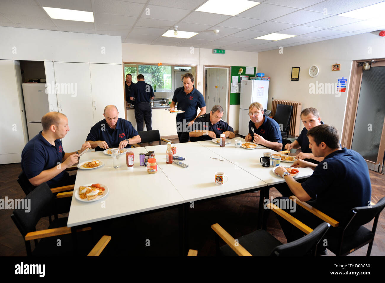 Fireman of white watch at Pontypridd Fire Station in S Wales UK in the canteen during a break from duty - Stock Image