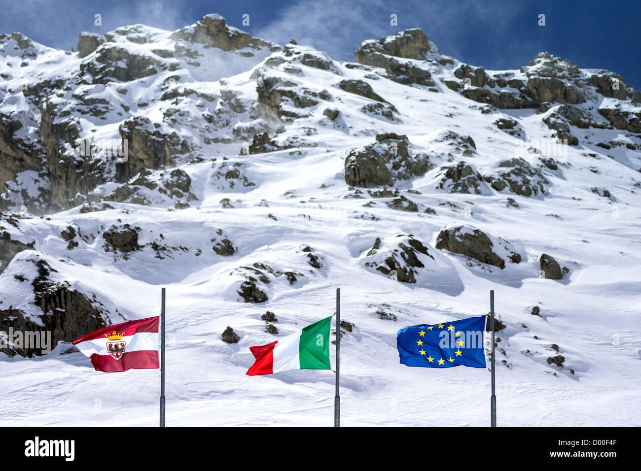Italy, Dolomites, Trentino Alto Adige, flags in the the Pordoi Pass - Stock Image