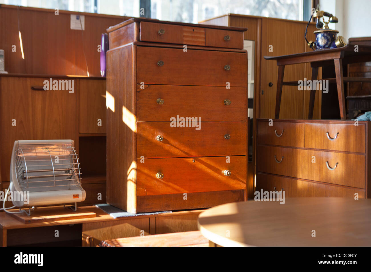 A family run furniture recycling depot in London. Secondhand furniture is re-sold at a very low price to low income - Stock Image