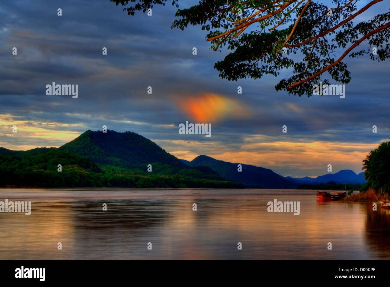 A phenomena called Sundog took place over the Mekong river, Luang Prabang - Stock Image